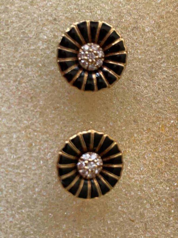 George Jensen Daisy earrings in black enamel and diamonds in yellow gold