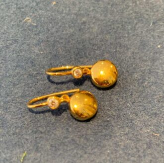 Georg Jensen earrings in 18 ct gold with a small diamond